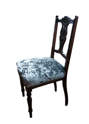 Ornate antique chair with crushed silver velvet